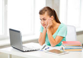 Stressed student with computer at home — Stock Photo