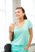Student holding take away coffee cup — Stock Photo