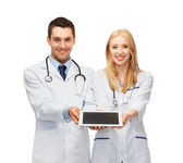 Young doctors showing tablet pc — Stock Photo