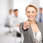 Businesswoman pointing her finger — Stockfoto