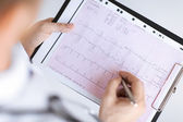 Male doctor hands with cardiogram — Foto Stock
