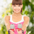 Fitness instructor with dumbbells — Stock Photo #26997613