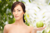 Young beautiful woman with green apple — Stock Photo