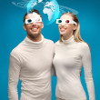 Woman and man in 3d glasses looking at globe model — Stock Photo