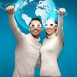 Woman and man in 3d glasses looking at globe model — Stock Photo #27049911
