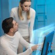 Man and woman working with virtual screen — Stock Photo #27049937