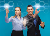 Man and woman working with virtual screen — Foto Stock
