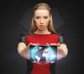 Woman holding tablet pc with sign of globe — Stock Photo