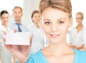 Woman with blank business or name card — Stock Photo