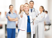 Attractive female doctor pointing her finger — Stock Photo