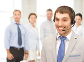 Friendly male helpline operator — Stock Photo