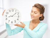 Woman with wall clock — Stock Photo