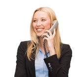 Smiling woman with phone — Stock Photo