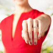 Woman showing wedding ring on her hand — Stock Photo #27095895
