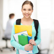 Student with books and schoolbag — Stock Photo #27095993