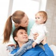 Happy parents playing with adorable baby — Stock Photo #27096089