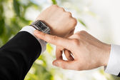 Man looking at wristwatch — Stock Photo