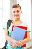 Chica estudiante con mochila y portátiles — Foto de Stock