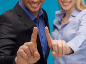 Man and woman hands pointing at something — Stock Photo