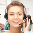 Helpline operator with headphones — Stock Photo #27309279