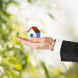 Man hands holding eco house — Stock Photo
