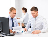 Businessmen with notebook and tablet pc — Stock Photo