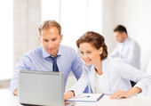 Man and woman working with laptop in office — Stock Photo
