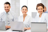 Group of working with laptops in office — Stock Photo