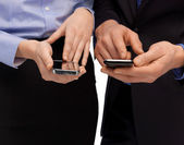 Woman and man hands with smartphones — Stock Photo