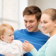 Happy family with adorable baby — Stock Photo