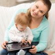 Stock Photo: Mother and adorable baby with tablet pc