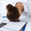 Woman sleeping at work in funny pose — Stock Photo #27351375