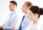 Businessmen and businesswomen on conference — Stock Photo