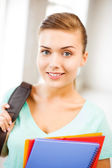 Student girl with school bag and color folders — Stock Photo