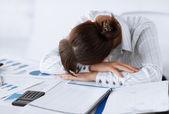 Tired woman sleeping at work — Stock Photo