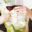 Engaged couple with wine glasses — Stock Photo