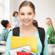 Stock Photo: Student girl with school bag and notebooks