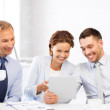 Business team having fun with tablet pc in office — Stock Photo