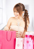 Girl with colorful gift bags — Stock Photo
