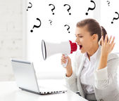 Strict businesswoman shouting in megaphone — Photo