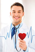 Doctor listening to heart beat — Stock Photo