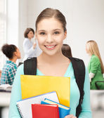 Student girl with school bag and notebooks — Stock Photo