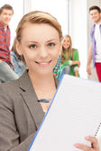 Teacher with big notepad at school — Stock Photo