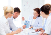 Business team discussing graphs in office — Stock Photo