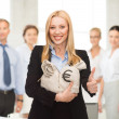Businesswoman with money bags showing thumbs up — Stock Photo #27578183