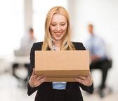 Businesswoman with cardboard box — Stock Photo