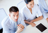 Serious businessman on meeting in office — Stock Photo