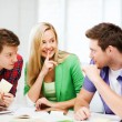 Group of students gossiping at school — Stock Photo #27719845