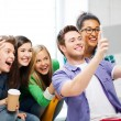 Students making picture with tablet pc at school — Stock Photo #27719999