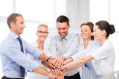 Business team celebrating victory in office — Stockfoto